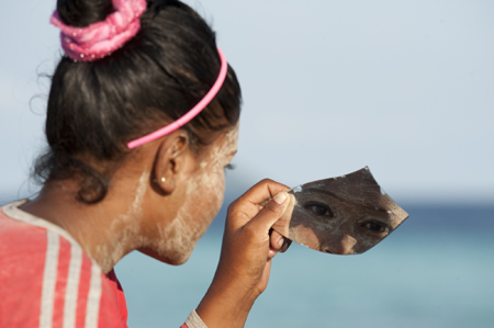Diana - a young woman Bajau Laut with burak on her face