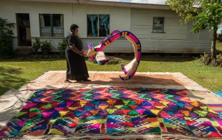 "Senior women from the family of the Taukei Namara (The Kingmaker of Naduri) showing their clan folks what they have put together as their presentation or ""reguregu"". The mats and masi are part of this family's presentation and the women will go to the mou"
